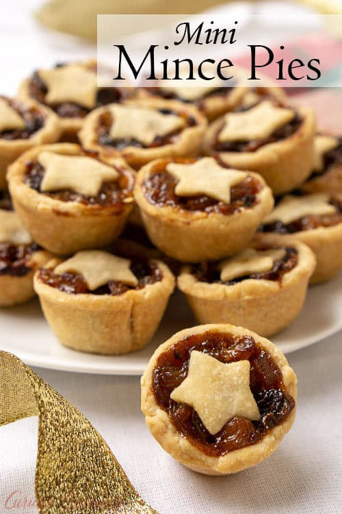 Mince Pies are a British Christmas staple. These sweet and boozy mini fruit pies are the perfect recipe to add to your Holiday cookie platter! | www.CuriousCuisiniere.com