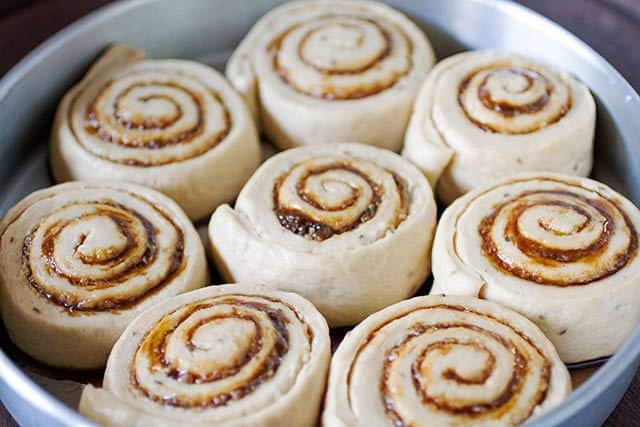 Golfeados Venezuelan Sticky Buns in the pan before baking | www.CuriousCuisiniere.com