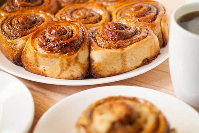 Golfeados Venezuelan Sticky Buns served with coffee | www.CuriousCuisiniere.com