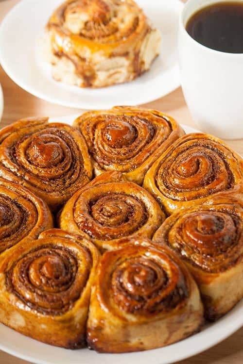 Call them cheesy rolls or sticky buns, Golfeados are a wonderful Venezuelan sweet and salty treat that combines robust panela sugar with a semi hard cheese. Serve these rolls with a hot beverage for breakfast, a morning snack, or afternoon tea! | www.CuriousCuisiniere.com