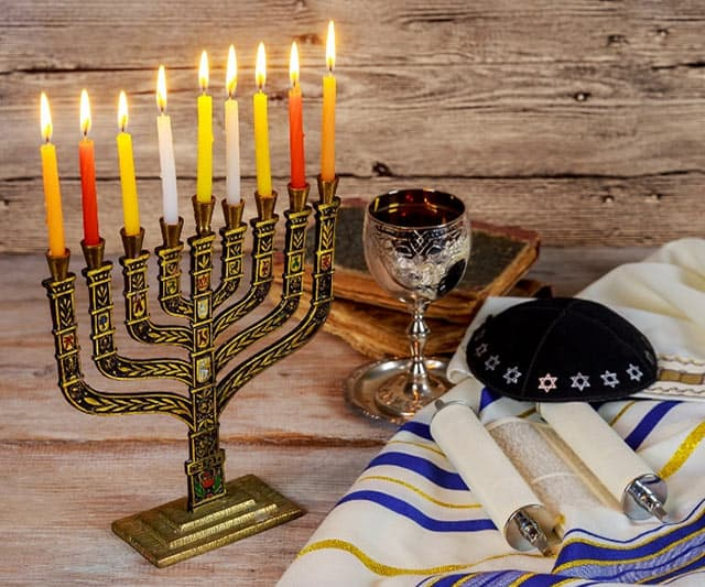 Hanukkah is one of them more well-known Jewish holidays. It's a time for lighting candles and eating fried food. But what does Hanukkah celebrate and how is it celebrated? Read on to learn more about the origins and traditions of Hanukkah! | www.CuriousCuisiniere.com