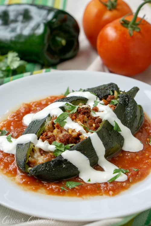 Baked Chiles Rellenos, filled with chorizo, rice, and melted cheese, are an easy way to enjoy Mexican stuffed peppers without all the hassle of frying. | www.CuriousCuisiniere.com