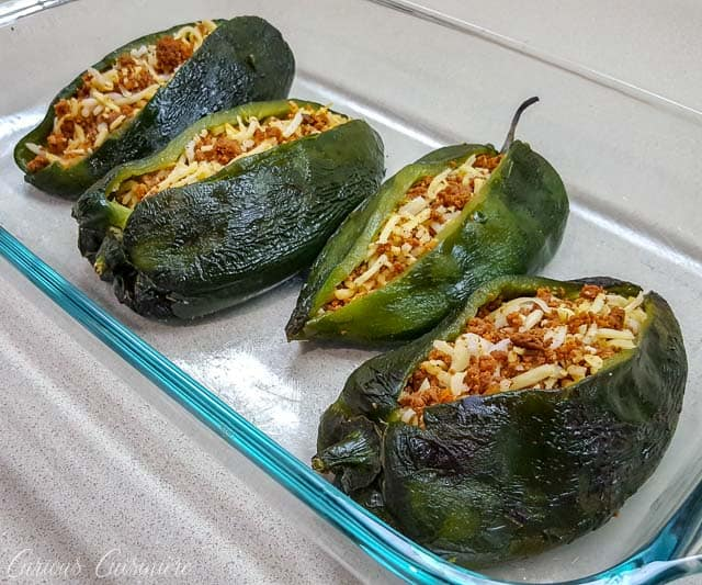 Chiles Rellenos with chorizo and chihuahua cheese ready for the oven. | www.CuriousCuisiniere.com