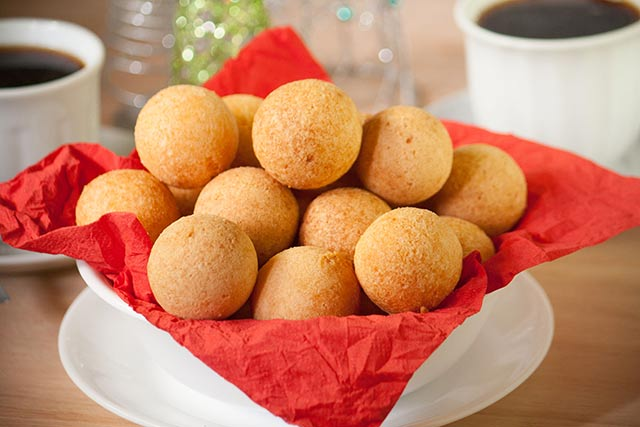 Colombian buñuelos or cheese fritters, are a mouthful of textures and flavors. They have a soft crumb and a crispy crust with a hint of sweetness and are a typical Colombian Christmas treat. | www.CuriousCuisiniere.com