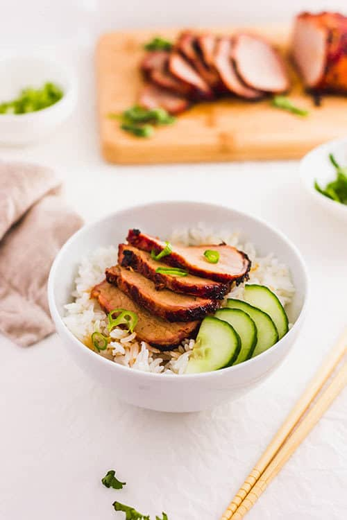 Char Siu over rice with vegetables in a bowl. | www.CuriousCuisiniere.com