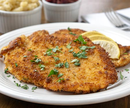 Hänchen-Schnitzel, German Chicken Schnitzel ,is an impressive, yet easy easy dinner recipe that the whole family will love. | www.CuriousCuisiniere.com