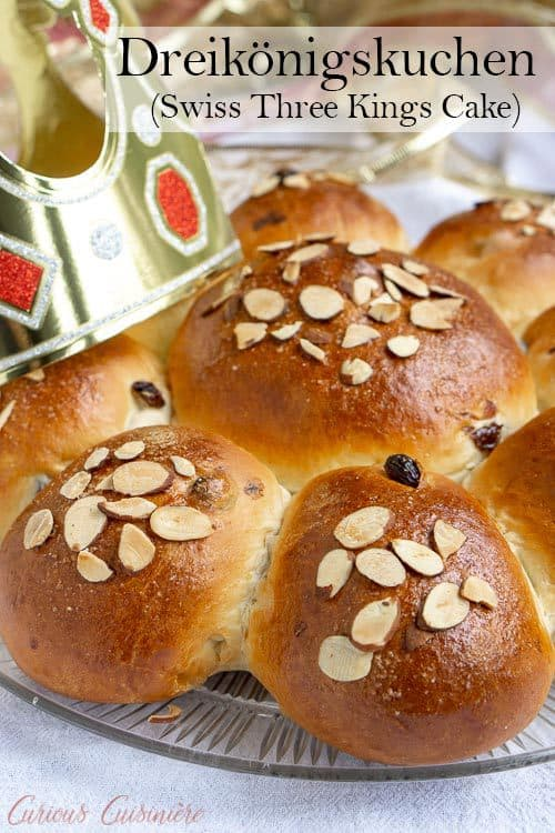 Dreikönigskuchen, Three Kings Cake, may also be called an Epiphany cake. These citrus and raisin bread rolls are lightly sweet and wonderfully fluffy! | www.CuriousCuisiniere.com