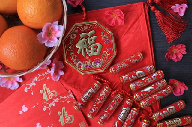 Firecrackers and mandarin oranges for the Chinese New Year
