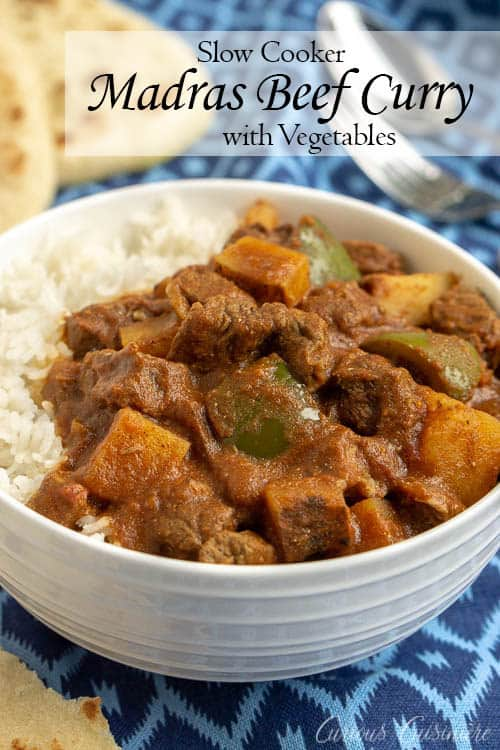 This Madras Curry is a warming dish that is perfect for a cool evening. This slow cooker beef curry brings deep, comforting flavors and tender meat with little effort. | www.CuriousCuisiniere.com