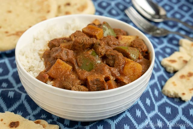 Madras Beef Curry with Vegetables and rice and naan flatbread. | www.CuriousCuisiniere.com