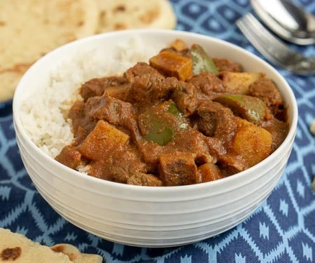 Madras Beef Curry with Vegetables and rice. | www.CuriousCuisiniere.com