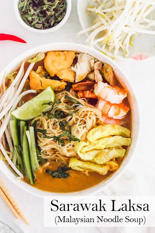 Sarawak Laksa is a comforting Malaysian noodle soup with Thai chiles, ginger, tamarind, and coconut milk. It is spicy, bright, warming, and full of flavour. | www.CuriousCuisiniere.com
