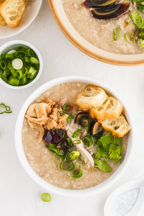 Pork congee with preserved century eggs. | www.CuriousCuisiniere.com