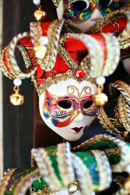 A white and red Mardi Gras mask from Venice, Italy