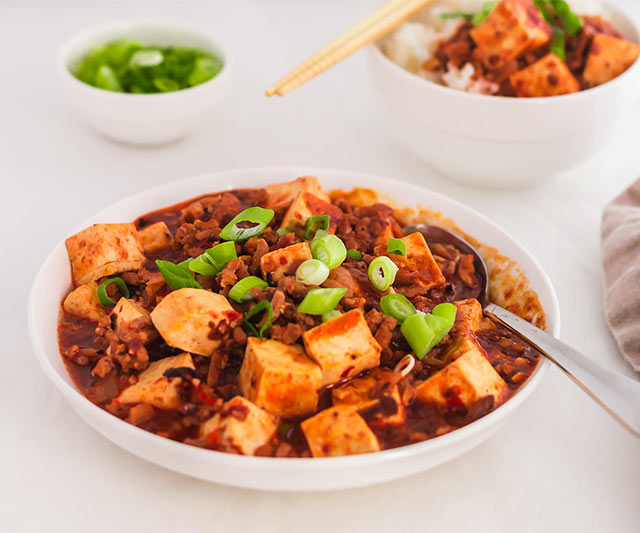 A serving bowl of Mapo Tofu, a quick Chinese Sichuan dinner recipe. | www.CuriousCuisiniere.com
