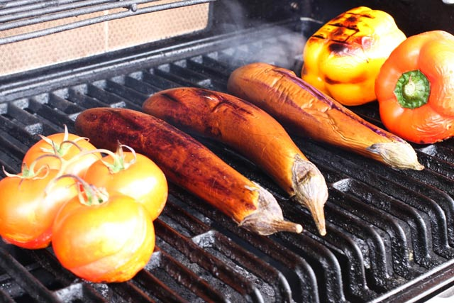Khorovats (Armenian Grilled Vegetables) tomatoes, Chinese eggplant, and yellow pepper on the grill