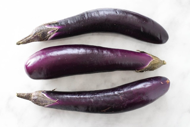 Three purple Chinese eggplant