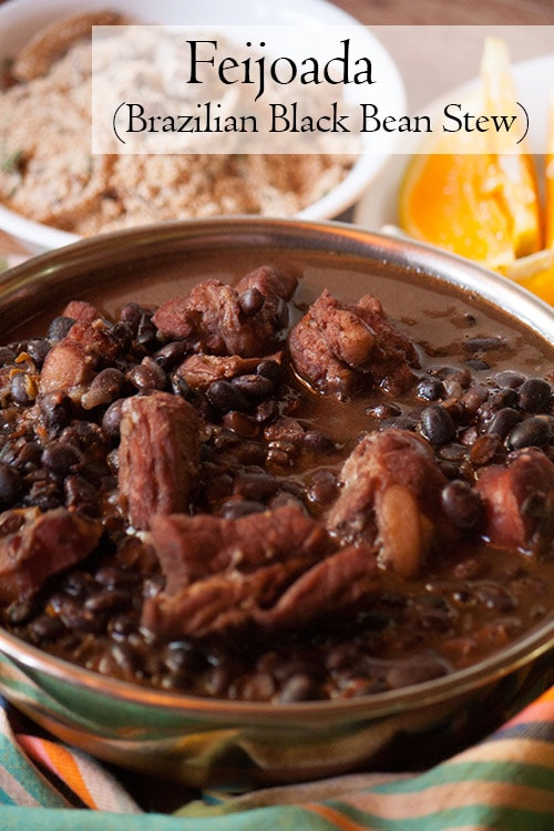 Feijoada, Brazilian black bean stew served with farofa and orange slices