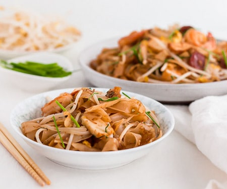 Malaysian Stir Fried Rice Noodles - Char Kway Teow - in a small bowl for serving with bean sprouts and chives