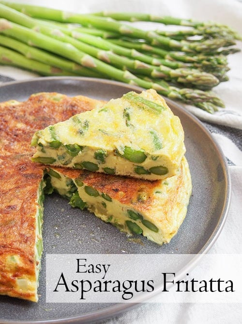 Asparagus fritatta, cut and plated with asparagus in the background and text.