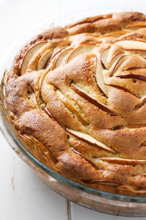 Closeup of the top of the Russian sharlotka apple cake decorated with sliced apples.