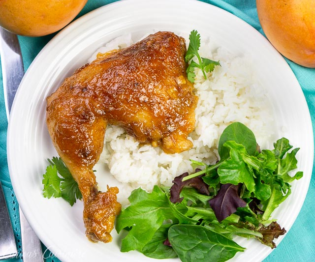 chicken on a white plate with salad