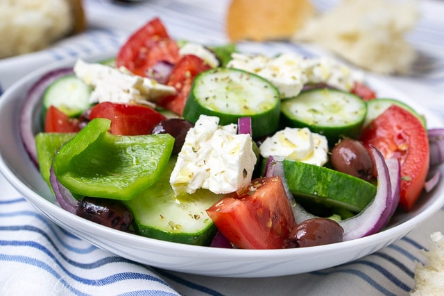 Authentic Greek salad (Horiatiki), a chunky salad without lettuce. Summer vegetables, salty olives, and creamy feta cheese.