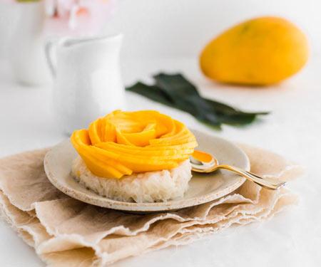 Thai mango sticky rice with decorative mango flower horizontal image small