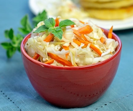 El Salvadoran Curdito pickled cabbage and carrot slaw in a red bowl small image