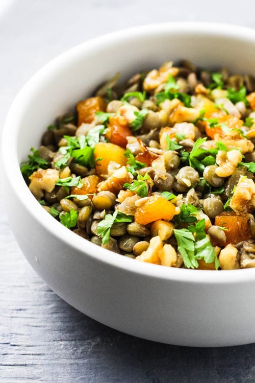 Mshosh Armenian salad with lentils, apricots, and walnuts in a white bowl.