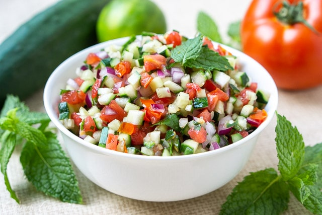 Persian Salad Shirazi, tomato and cucumber salad with lime and mint in a white bowl