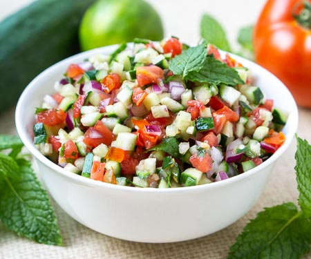 Persian Salad Shirazi, tomato and cucumber salad with lime and mint in a white bowl small image