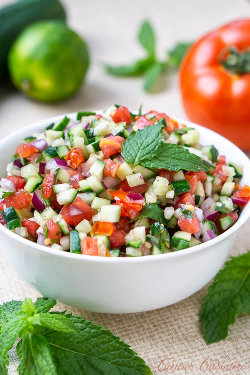 Persian Salad Shirazi, tomato and cucumber salad with lime and mint.