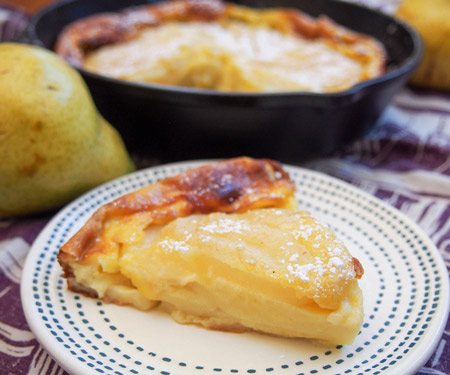 Slice of pear clafoutis.