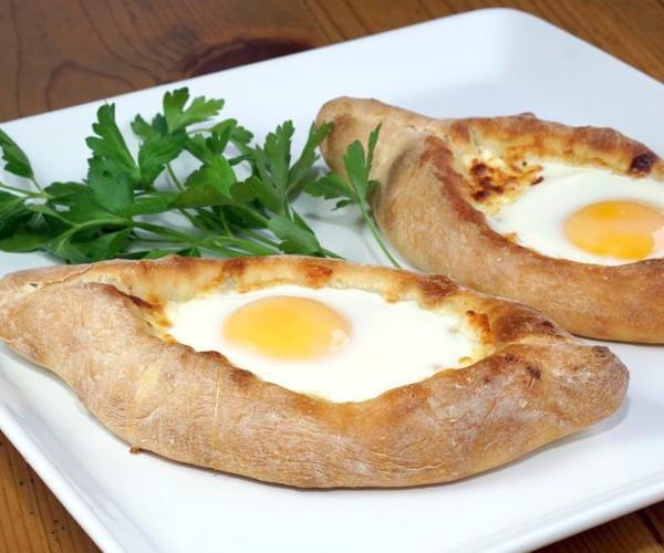 Adjaruli Khachapuri (Georgian Cheese Bread) with soft cooked egg