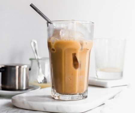 Tall glass of Vietnamese iced coffee horizontal image