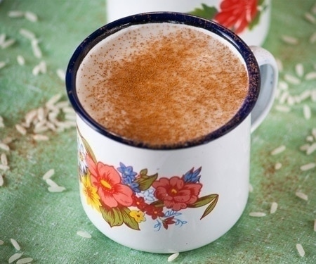 A floral mug of Guatemalan Atolillo Hot Rice Atole Drink