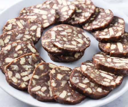 Russian Chocolate Salami sliced on a platter