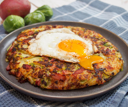 Bubble and Squeak (British Potato Cakes) and an egg with broken yolk