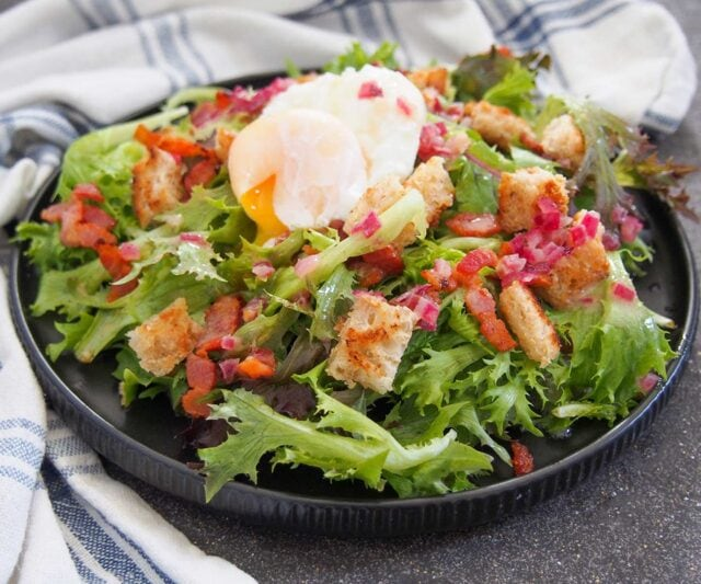 Salade Lyonnaise (Warm Bacon and Egg Salad) with frisee and croutons