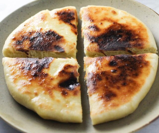Imeruli Khachapuri - Georgian cheese filled bread cut into quarters