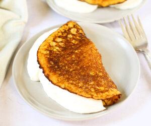 Cachapas (Venezuelan corn pancakes) with soft cheese