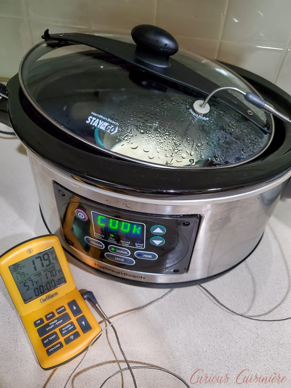 Homemade clotted cream made in the slow cooker - with probe thermometer to check temperature