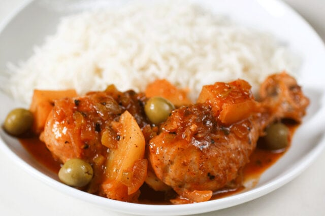 Cuban Chicken Fricassee - chicken leg and rice up close