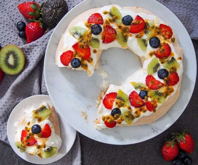 Australian Christmas Pavlova wreath with a slice out