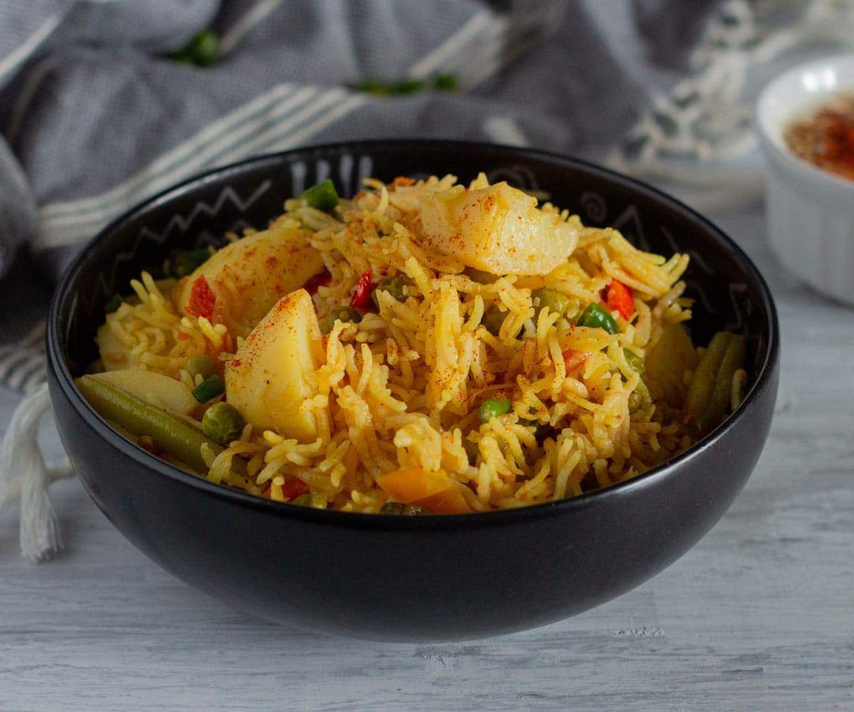 Vegetable Tehri (North Indian Vegetable Spiced Rice) with potatoes and peas