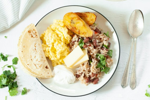 Gallo Pinto (Rice and Beans) for breakfast with eggs, cheese and fried plantains
