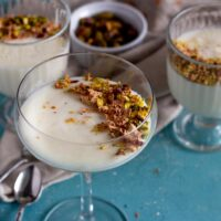 Mahalabia - Middle Eastern milk pudding topped with nuts and rose petals