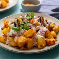 Alloo Chaat - plate of curried potatoes - cropped image